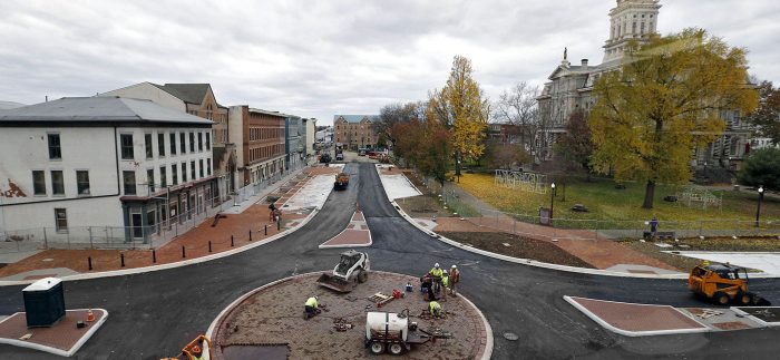 Construction crews apply fresh asphalt on the roads and place pavers in a new roundabout as work on sewer overhauls and streetscape renovations on the south side of the square in downtown Newark nears completion. Photographed on November 12, 2015.  (Chris Russell/Dispatch Photo)